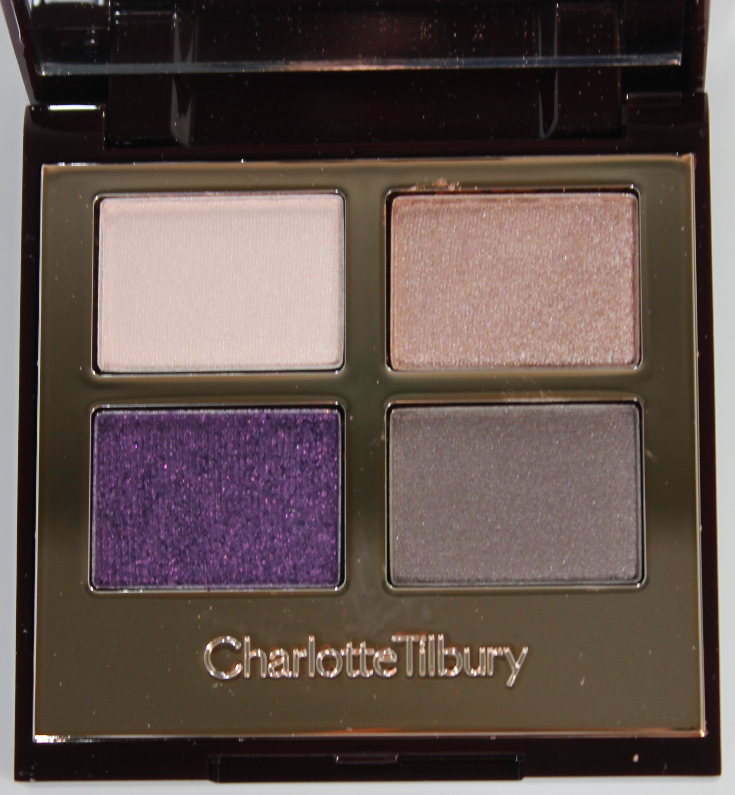 Charlotte Tilbury The Glamour Muse and The Rebel Color-Coded Eyeshadow Palettes graphic